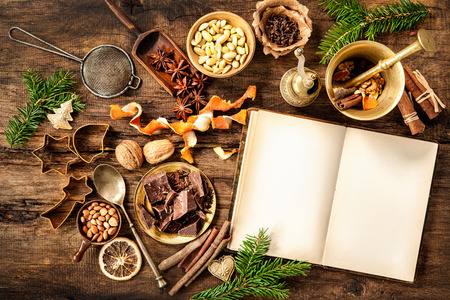 Baking concept background with cookbook, spices and utensils for Christmas cookies