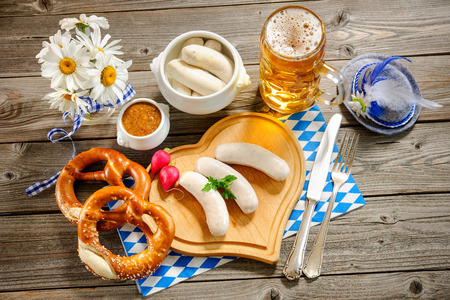 scalded sausage: Traditional Bavarian meal. White sausage with sweet mustard and pretzel Stock Photo