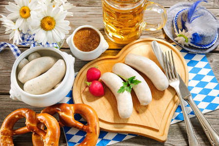 sweet mustard: Traditional Bavarian meal. White sausage with sweet mustard and pretzel Stock Photo