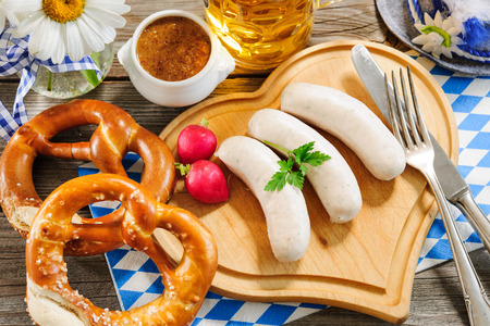 veal sausage: Traditional Bavarian meal. White sausage with sweet mustard and pretzel Stock Photo