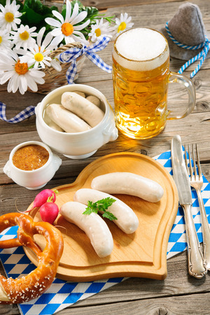 weisswurst: Traditional Bavarian meal. White sausage with sweet mustard and pretzel Stock Photo