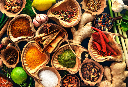 Various herbs and spices on wooden table