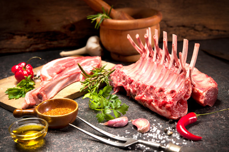 rack of lamb: Racks of lamb ready for cooking on dark background