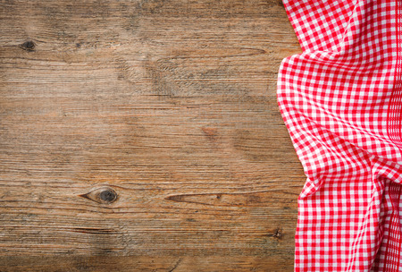 checkered background: Red checkered tablecloth on wooden table