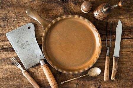 vintage kitchen: Vintage kitchen utensils on wooden table