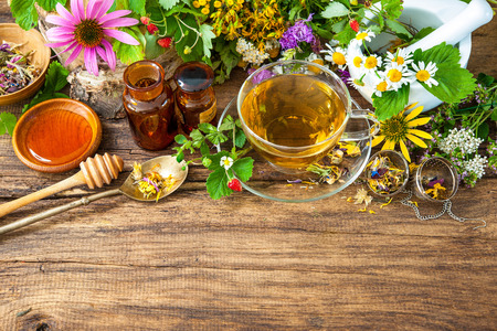 tea hot drink: Cup of herbal tea with wild flowers and various herbs