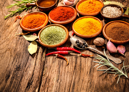 kulinarne: Various herbs and spices on wooden table