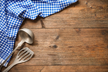 seasoning: Kitchenware on wooden table with a blue checkered tablecloth