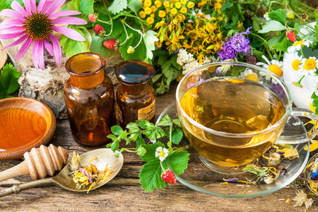 herbal: Cup of herbal tea with wild flowers and various herbs