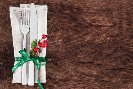Christmas table place setting with christmas pine branches,ribbon and bow. Christmas holidays background Archivio Fotografico