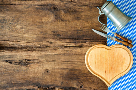 Background for Bavarian cuisine with a blue checkered tablecloth