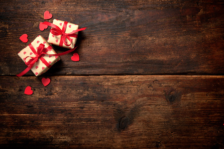 birthday present: Gift boxes over dark wooden background