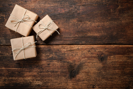 christmas present: Gift boxes over dark wooden background