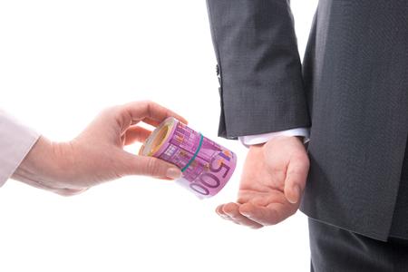 venality: Concept - corruption. Businessman in a suit takes a bribe
