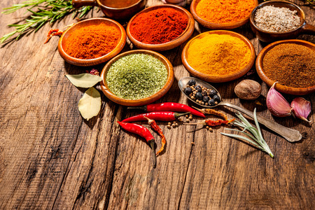 cooking ingredients: Various herbs and spices on wooden table