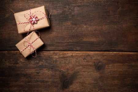 Christmas gift boxes and decoration over grunge wooden background Archivio Fotografico
