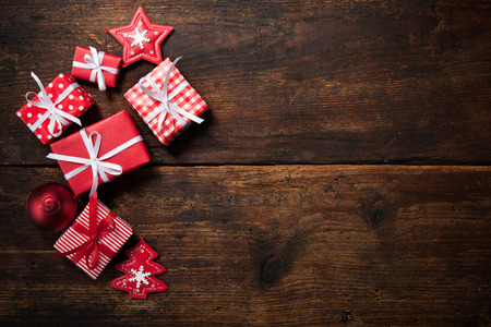 christmas bauble: Christmas gift boxes and decoration over grunge wooden background Stock Photo