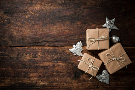 Christmas gift boxes and decoration over grunge wooden background Stock Photo