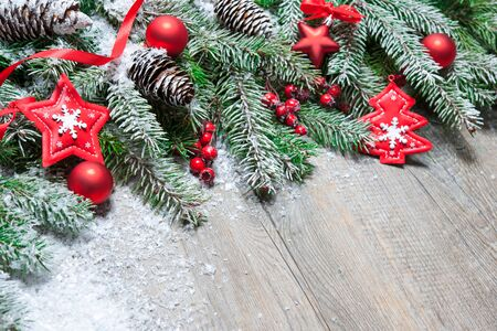 fir tree: Fir tree branches with christmas decoration on old wooden board