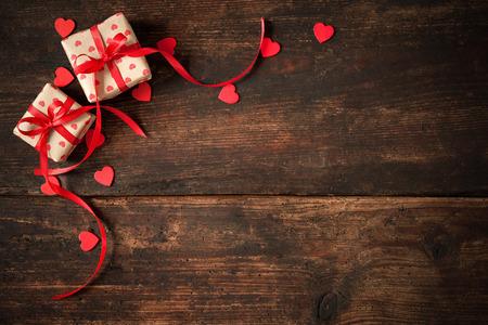 dark red: Gift boxes over dark wooden background