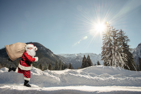men running: Santa Claus running with the bag of the presents