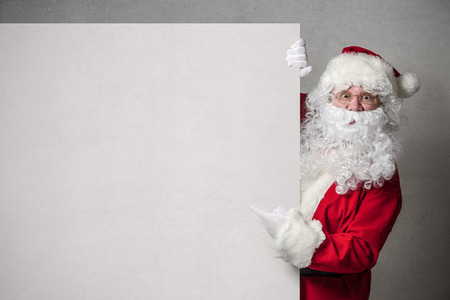 Santa Claus pointing in blank sign