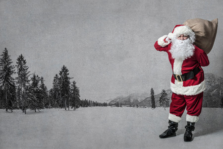 Santa Claus with a big bag of presents Stock Photo