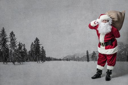 hat of santa claus: Santa Claus with a big bag of presents Stock Photo