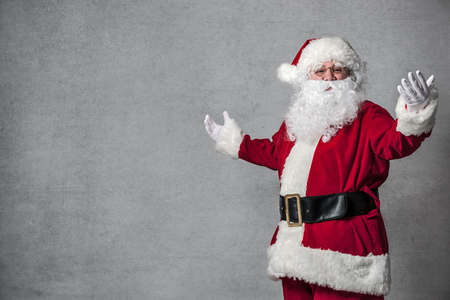 Santa Claus welcomes with spread arms