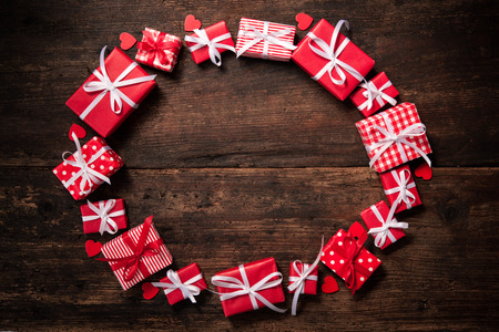gift bow: Frame from gift boxes over dark wooden background