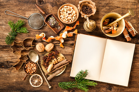 cook book: Baking concept background with cookbook, spices and utensils for Christmas cookies