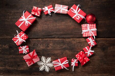 gift boxes: Frame from Christmas gift boxes and decoration over grunge wooden background Stock Photo