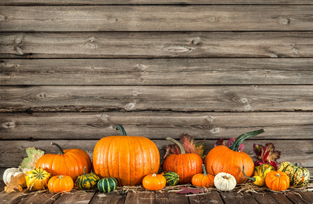 pumpkin leaves: Autumn still life with pumpkins and leaves on old wooden background