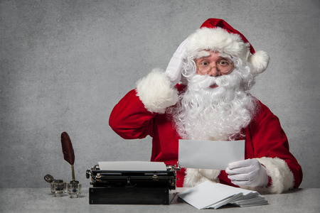 old letters: Santa Claus typing a letter on an old typewriter Stock Photo