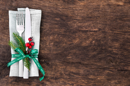 Christmas table place setting with christmas pine branches,ribbon and bow. Christmas holidays background Stock Photo