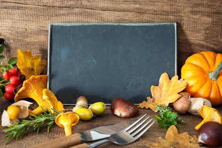 Thanksgiving still life with mushrooms, seasonal fruit and vegetables on wooden table with space for text.  Cooking concept Stock Photo
