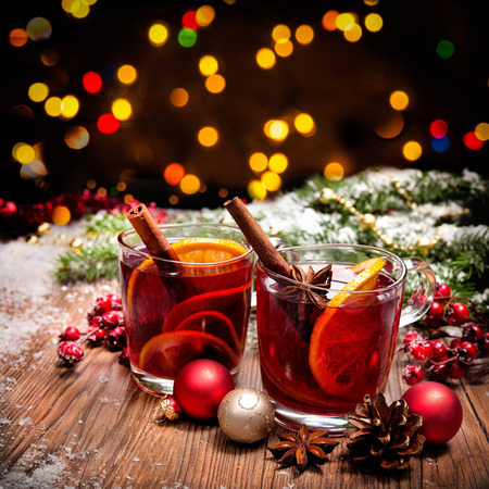 lights: Two glasses of  mulled wine with christmas decoration