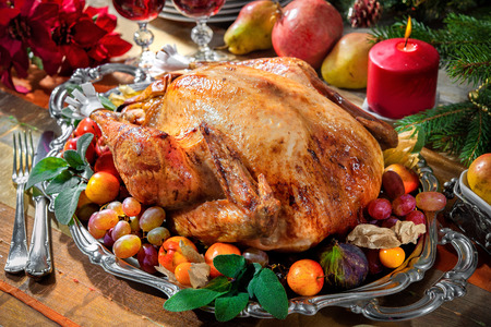 traditional christmas dinner: Roasted turkey on holiday table with candles Stock Photo