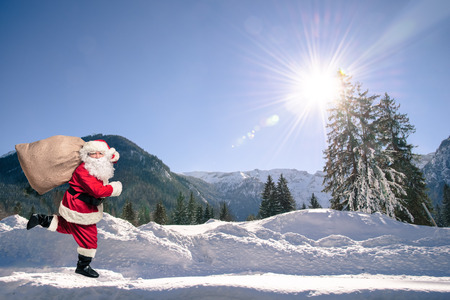 christmas fun: Santa Claus running with the bag of the presents
