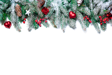christmas decorations with white background: Christmas Border. Tree branches with baubles, stars, snowflakes isolated on white