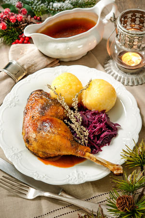 red cabbage: Crusty Christmas goose leg with braised red cabbage and dumplings