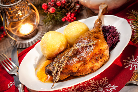red braised: Crusty Christmas goose leg with braised red cabbage and dumplings