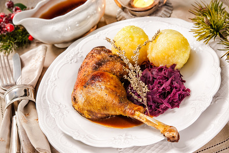 Crusty Christmas goose leg with braised red cabbage and dumplings