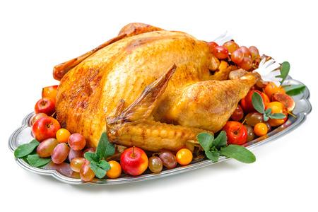 Garnished roasted turkey on platter over white background Standard-Bild
