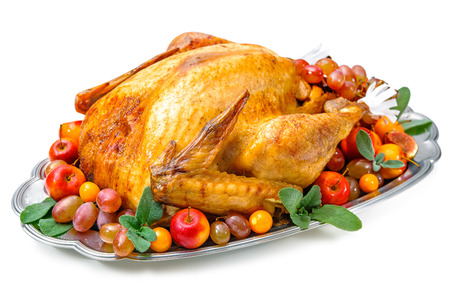 feasts: Garnished roasted turkey on platter over white background Stock Photo