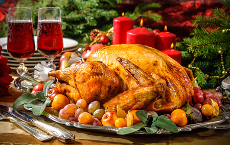 roast turkey: Roasted turkey on holiday table with candles Stock Photo