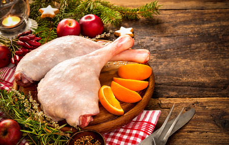 Raw goose legs with herbs on cutting board. Cooking at Christmas time Stock fotó - 47931578