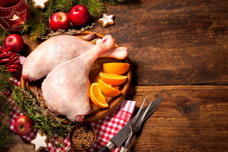 christmas goose: Raw goose legs with herbs on cutting board. Cooking at Christmas time