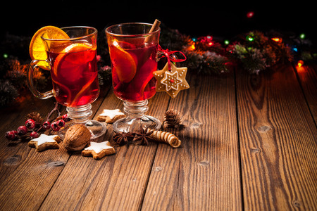warm drink: Two glasses of hot mulled wine with oranges and spices
