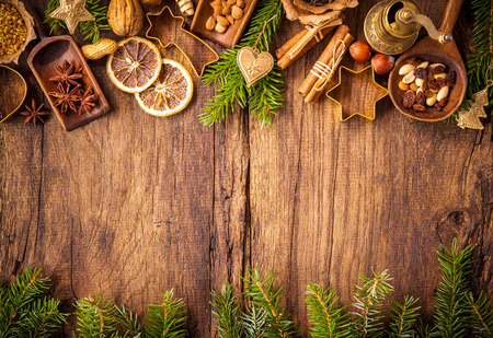 christmas cooking: Baking concept background with spices and utensils for Christmas cookies Stock Photo